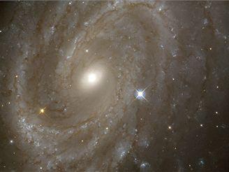 Spirálová galaxie NGC 4603, nejvzdálenější, kde HST studoval cefeidy