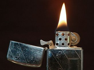 Close-up of a lit 1968 slim model Zippo lighter