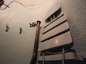 Sedátko ve zvonu a ukončení potrubního telefonu