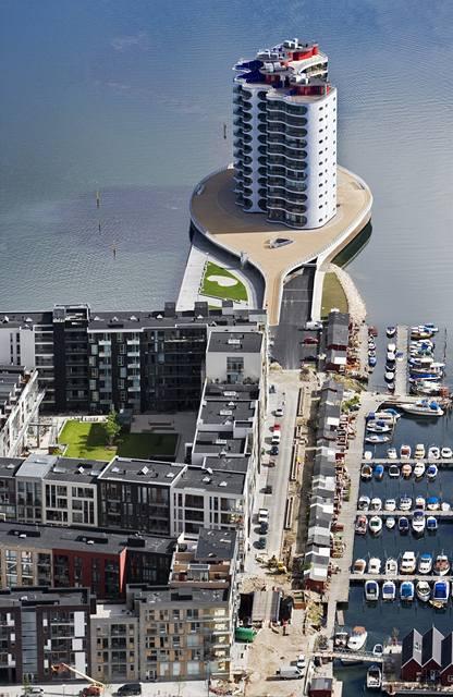 Dům Metropolis se naprosto odlišuje od ostatních domů ve čtvrti, ale i v Dánsku vůbec