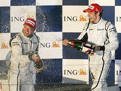 Jenson Button (vpravo) a Rubens Barrichello