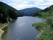 Pokud si trasu zkrátíte Masarykovým údolím, naskutne se vám zde pohled na malebnou zátoku přehrady Šance