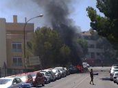 Turisté sledují místo výbuchu v Palmanově (30. července 2009)