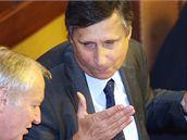 Premiér Jan Fischer s ministrem financí Eduardem Janotou v Poslanecké sněmovně. (15. září 2009)