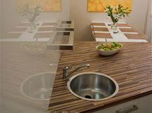 Vkuchyni je myčka, proto sem designéři navrhli jen jednoduchý kulatý dřez