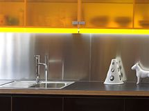 Kuchyňská linka vzhledem ladí se zbývajícím zařízením