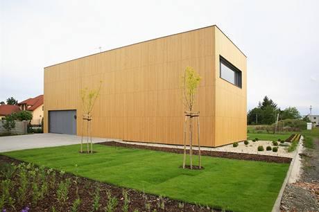 Zděný dům s dřevěnou fasádou