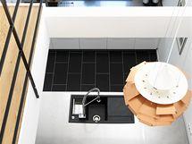 """Průhled z patra do kuchyně byl další architektův dobrý nápad. Kuchyň je díky tomu dostatečně osvětlena denním světlem. Mezi patry visí velká měděná lampa """"Šiška"""", kterou navrhl designér Poul Henningsen."""