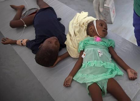 Lékař tuto haitskou holčičku dvě minuty po pořízení snímku prohlásil za mrtvou. Zemřela na choleru, která sužuje celý ostrov