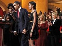 Manželé Obamovi s dětmi, Mariah Carey a Ellen Degeneresová ve Washingtonu