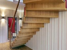 Z přízemí se po schodech vyjde do prvního patra s kuchyní a obývacím pokojem.