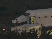 Transportní vozidlo přijíždí vyzvednout posádku.