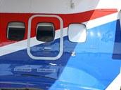 Verzi UVP-E20 mimo jiné přibyly na bocích nad podvozkech dva nouzové východy. U