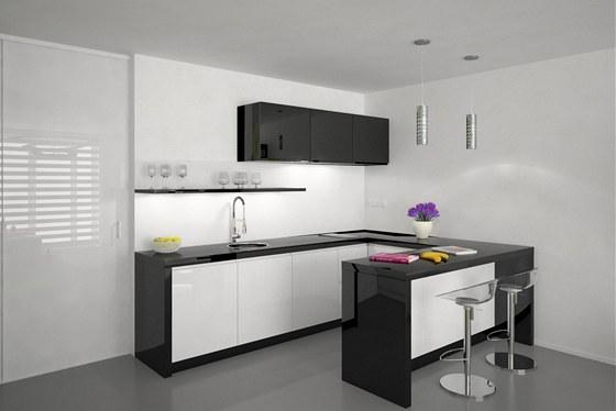 Kuchyni odděluje od obývací části barový pult sloužící zároveň ke stolování.