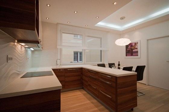 Nové uspořádání pracovní části kuchyně je ve tvaru písmene U.