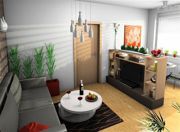 Prostor s pohovkou je od jídelní �ásti odd�lený nízkou nábytkovou sestavou s