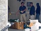 Policie prohledává dům, ve kterém Megan Huntsmanová dříve žila (Utah, 13. dubna 2014).