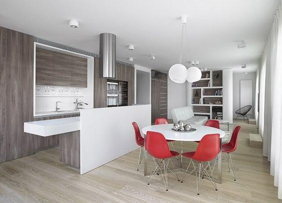 Pracovní deska na jedné straně přesahuje kuchyňský ostrůvek. Stačí tedy přisunout několik vyšších židlí a může sloužit jako barové sezení nebo snídaňový pult.